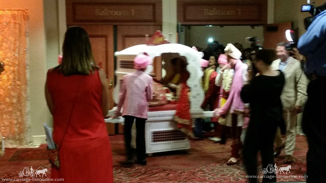 The bride getting rolled out in our Indian wedding Doli