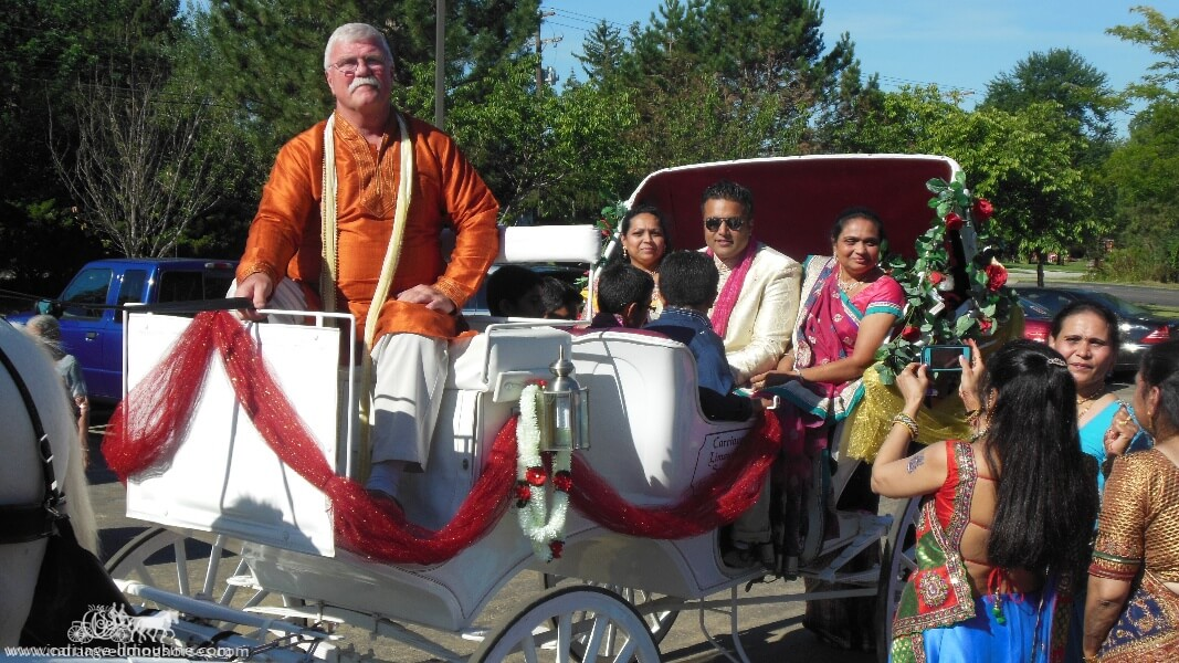 The groom and family on their way to the wedding in our Indian Wedding Carriage in Brunswick, OH