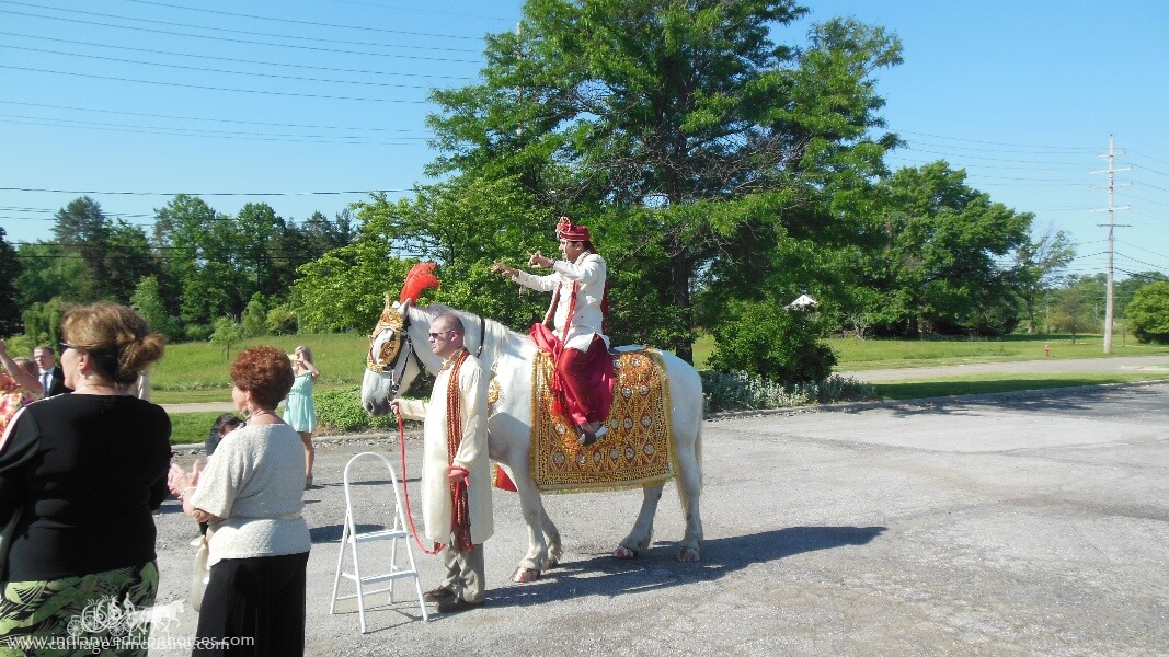 Groom on horseback during Baraat at Executive Caterers Landerhaven in Mayfield Heights OH