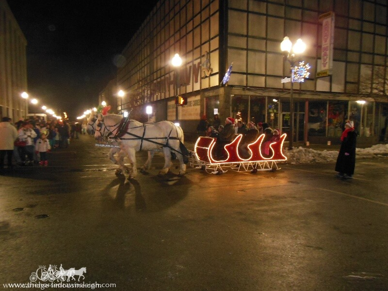 Our Horse Drawn Sleigh giving rides during a holiday event in Sharon PA
