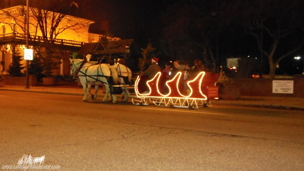 Our Horse Drawn Sleigh giving rides during a holiday event in Canton Ohio